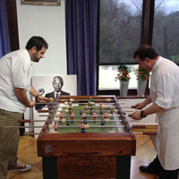 Grand cooks playing table soccer